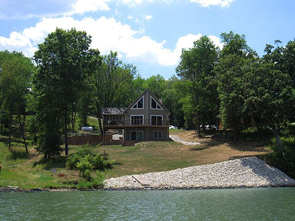 Secluded Wooded Iowa Property With Lakefront Home Beneath Trees